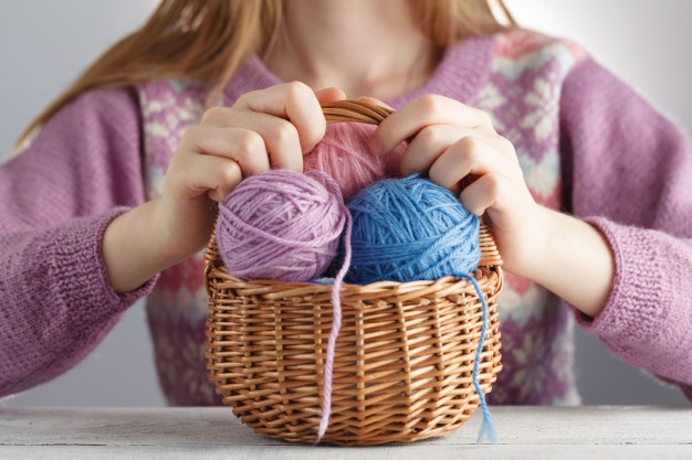clew-of-wool-in-woman-hands_155165-9702